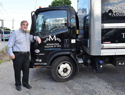 TediMatts owner, Ted Mottola, standing next to a tediMatts truck.