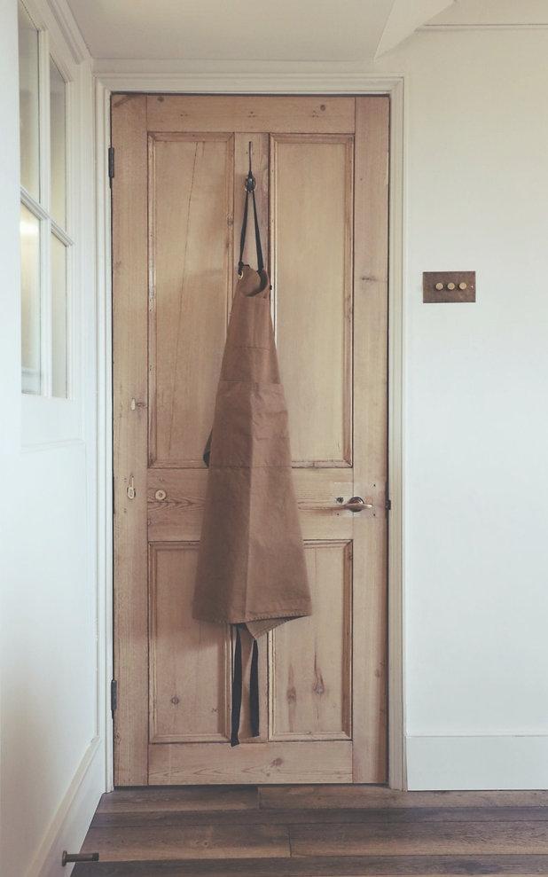 brown apron hangs on a wooden door