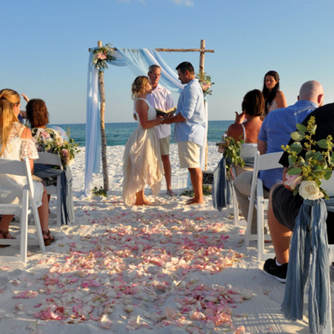 The Brides smmoth aisleway on Navarre Beach with roses