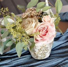 Blush and greenery make this centerpiece just perfect