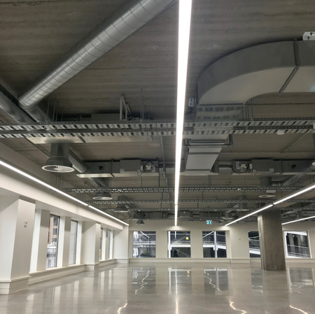 Commercial Base build linear LED lighting and cable tray installation