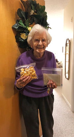 Resident holding a bag of popcorn
