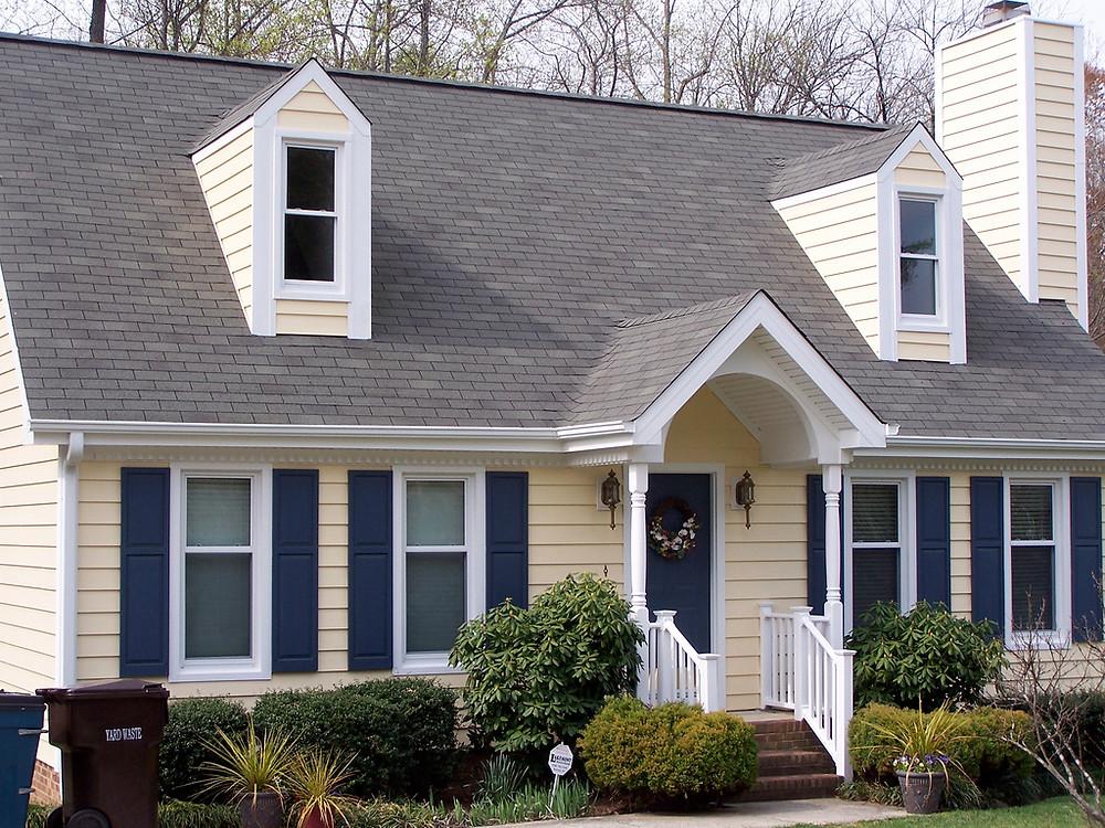 Residential, suburban house with white, vinyl windows