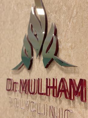 Logo of Dr Mulham Polyclinic in Dubai.