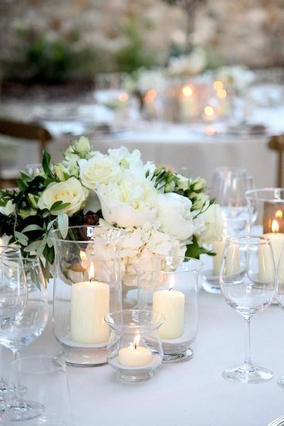 Table Setting with white roses, candles,