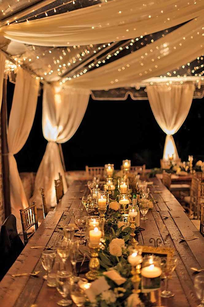 Rustic Table Setting with candles, wooden table, and wreath garland