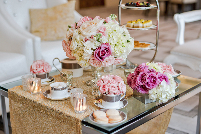 High Tea Setting with flowers and dessert assortment