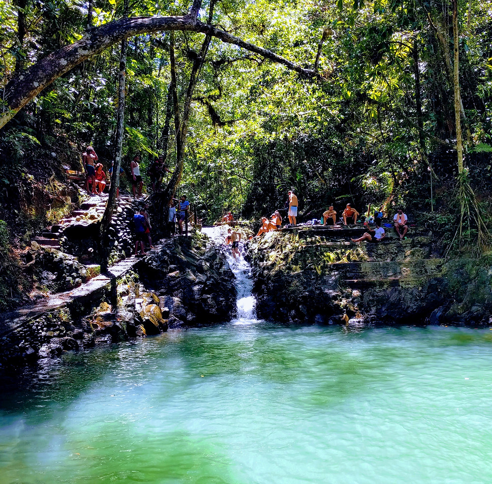 people enjoying a swimming hole