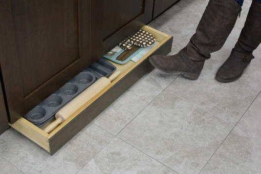 Toe kick space drawer storage