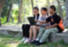 three-asian-boy-and-girls-playing-laptop