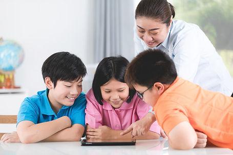 asian-teacher-kids-entertaining-themselv