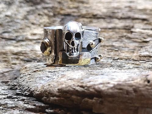 Fused textured silver &18 carat gold skull ring