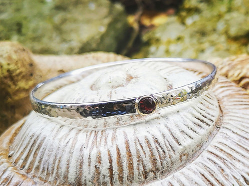 Beaten Sterling Silver and 9 Carat gold bangle with Gemstone.