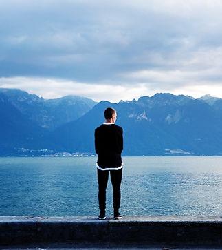 Man overlooking water