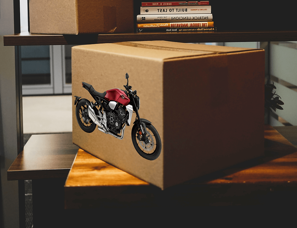 Box with red motorcycle sticked on