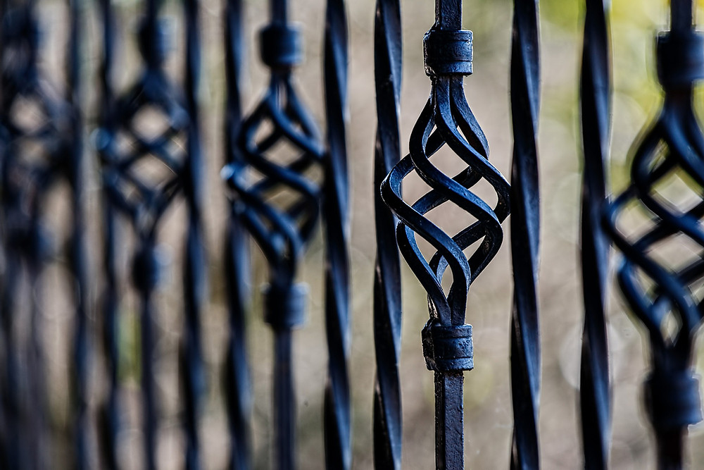 black wrought iron fence detail