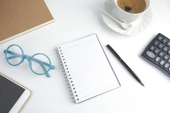 blank-page-notebook-desktop-with-pen-cof