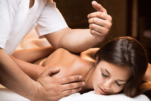The girl enjoys deep tissue massage.jpg