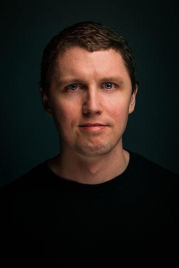 Dan Brugere Headshot Black Shirt-1.jpg