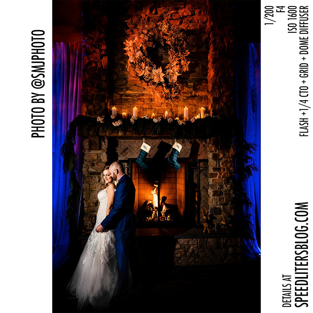 Beautiful composite image of bride and groom by a fireplace. Taken by Sony A7III and lit by Godox AD200.