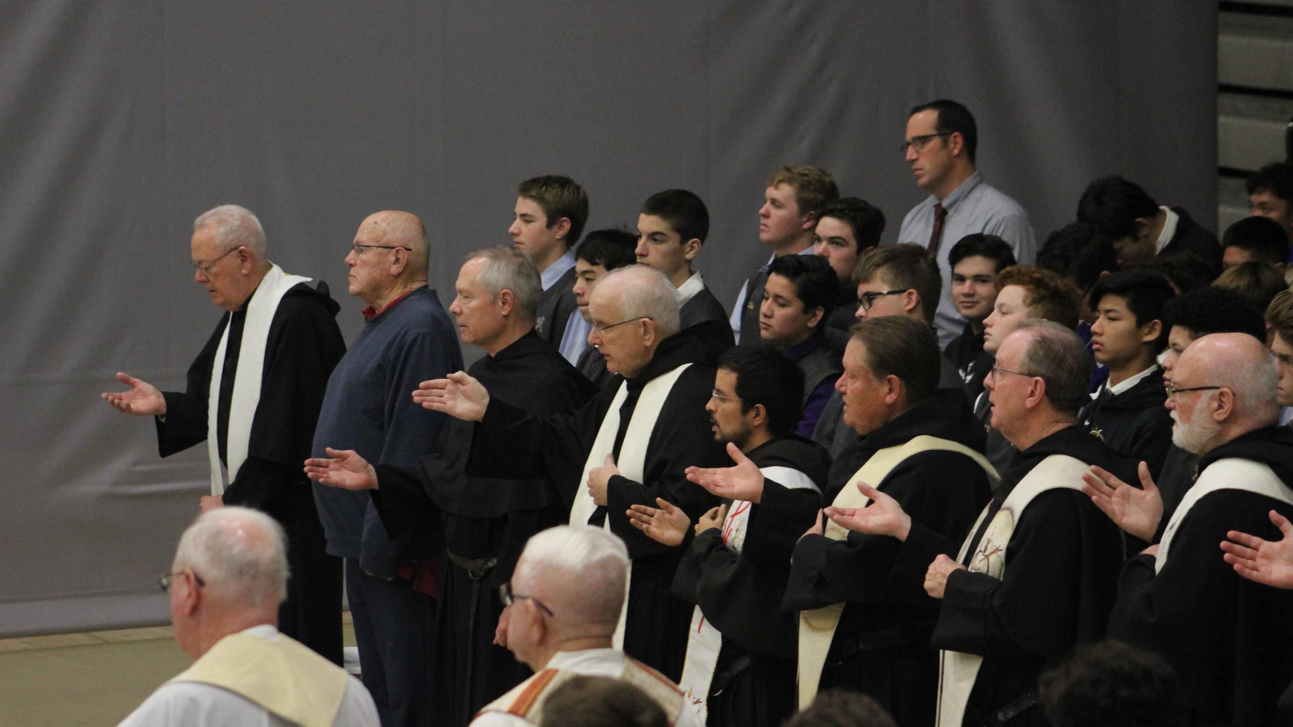 Concelebrants in prayer