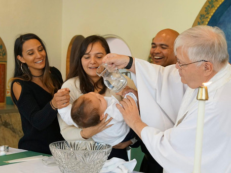 Br. Dominic Leads Family on Baptismal Journey