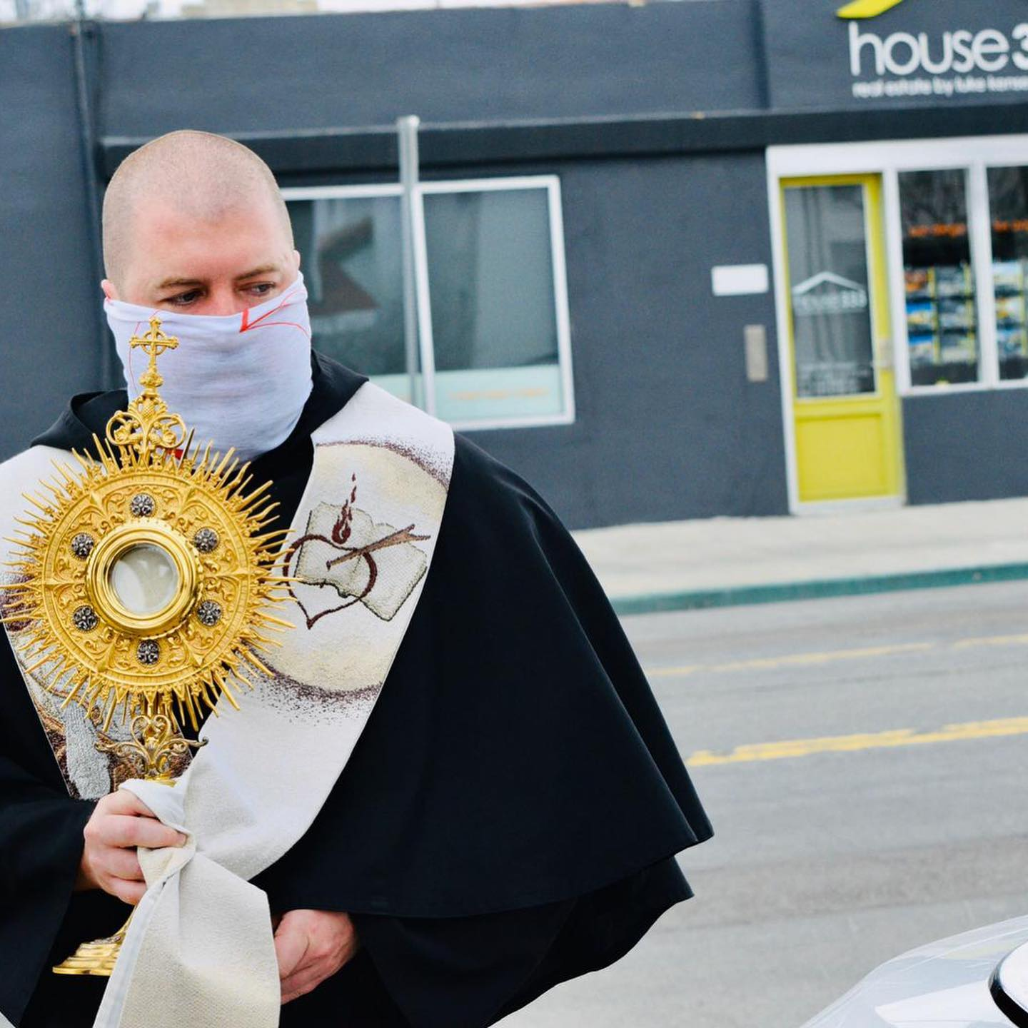 Fr Max holds the Blessed Sacrament