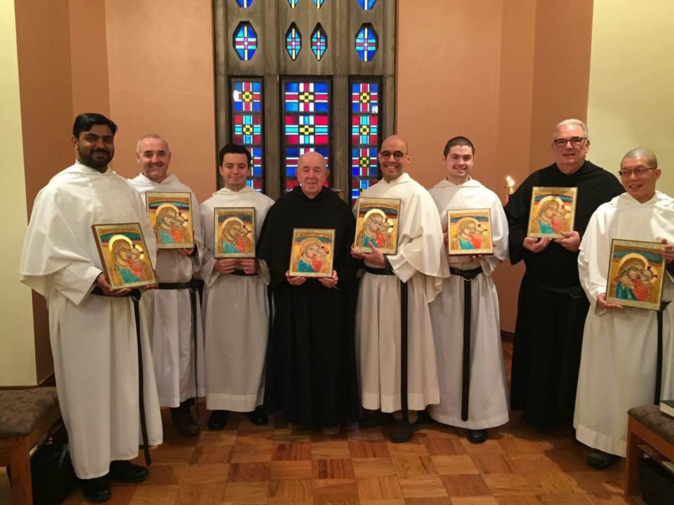 Br. Manny (left) and the novice class present their icons, Fr. Richard can be seen in black on the right