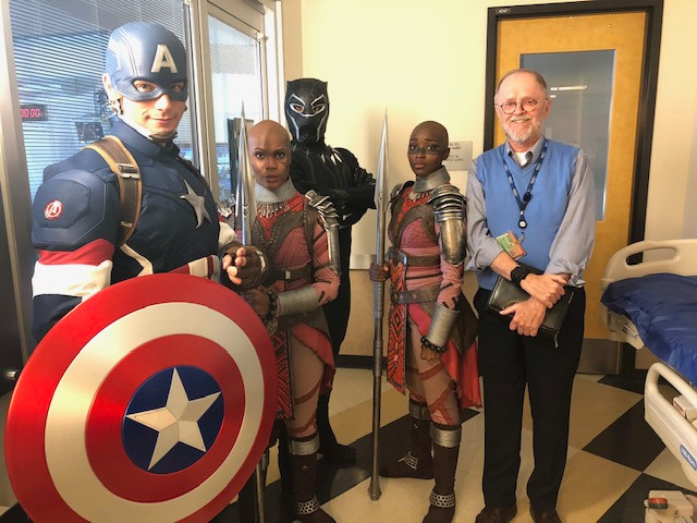 Fr. Jim joins super heroes making the rounds at Children's Hospital LA