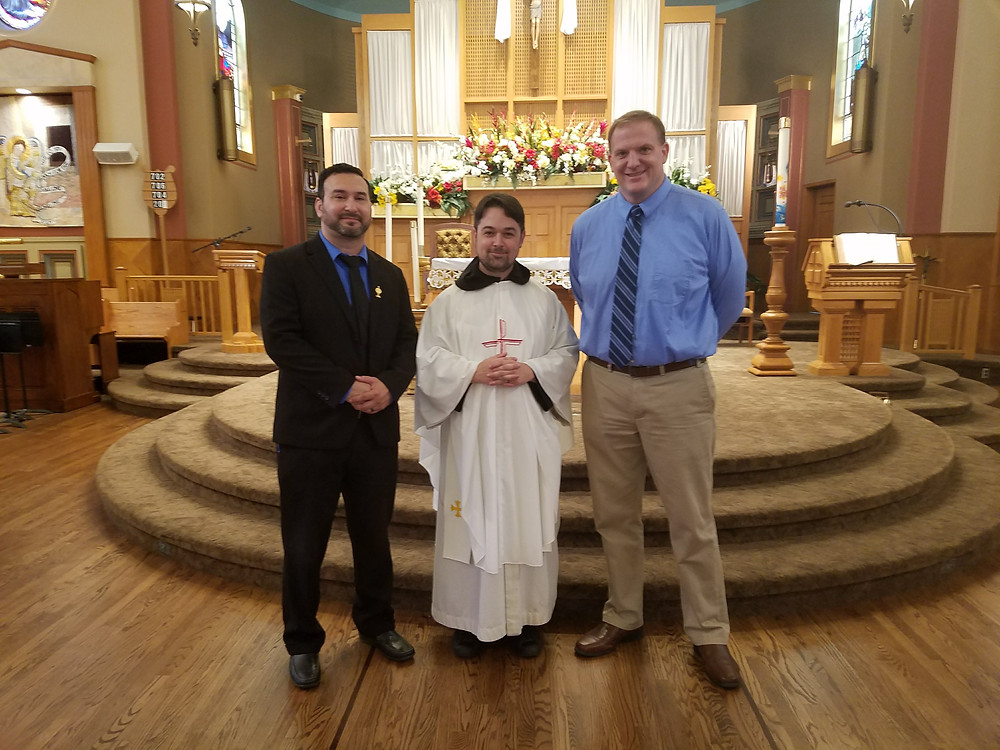 Fr. Mark with Principal Stumpf (Left) and Campus Minister Sandoval (Right)