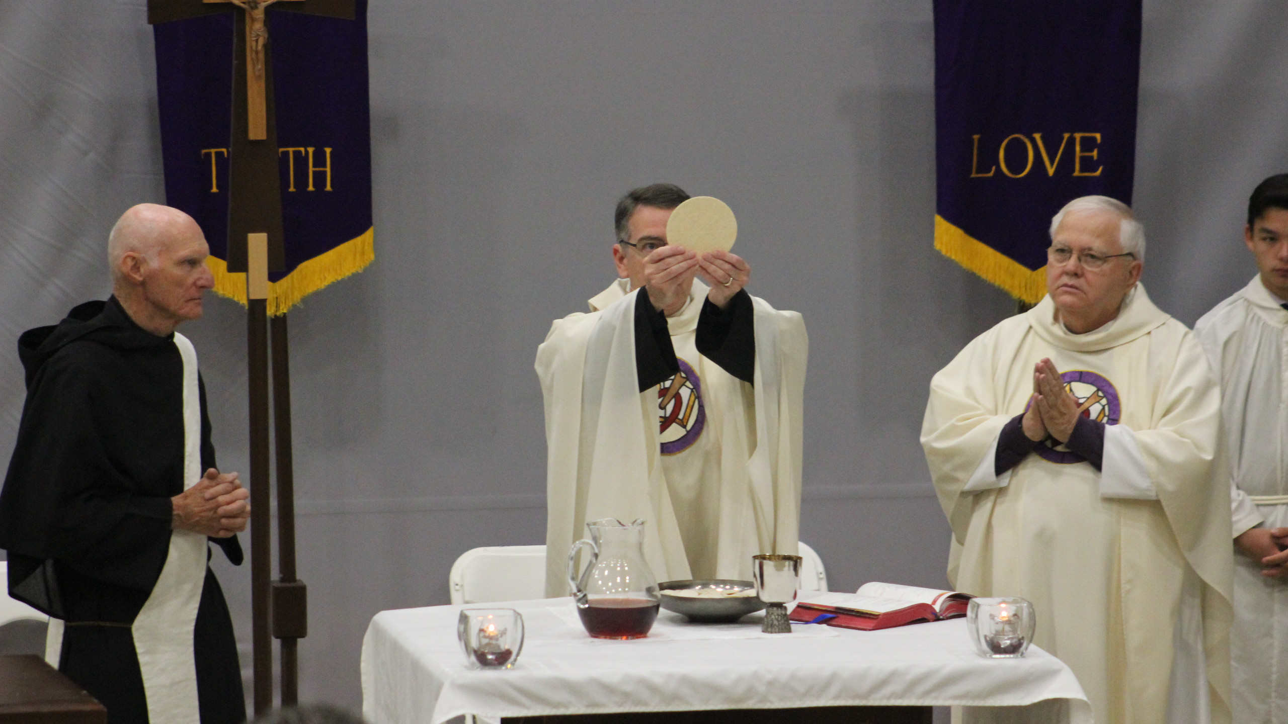 Fr. Joe offering the Eucharist
