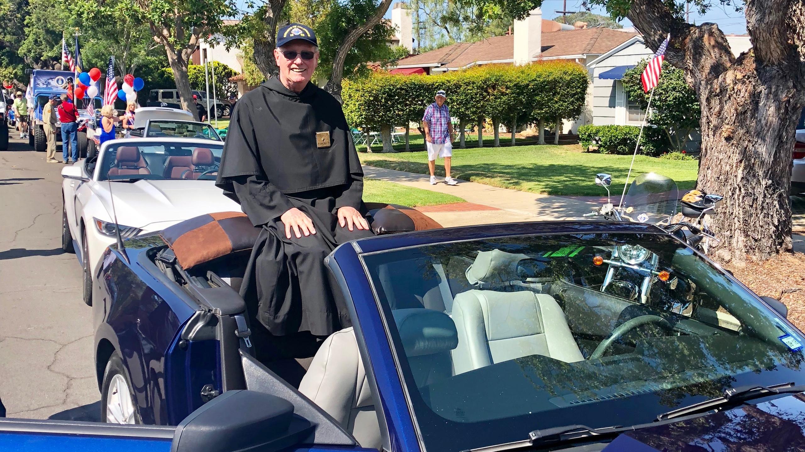 Fr. John with KofC Car