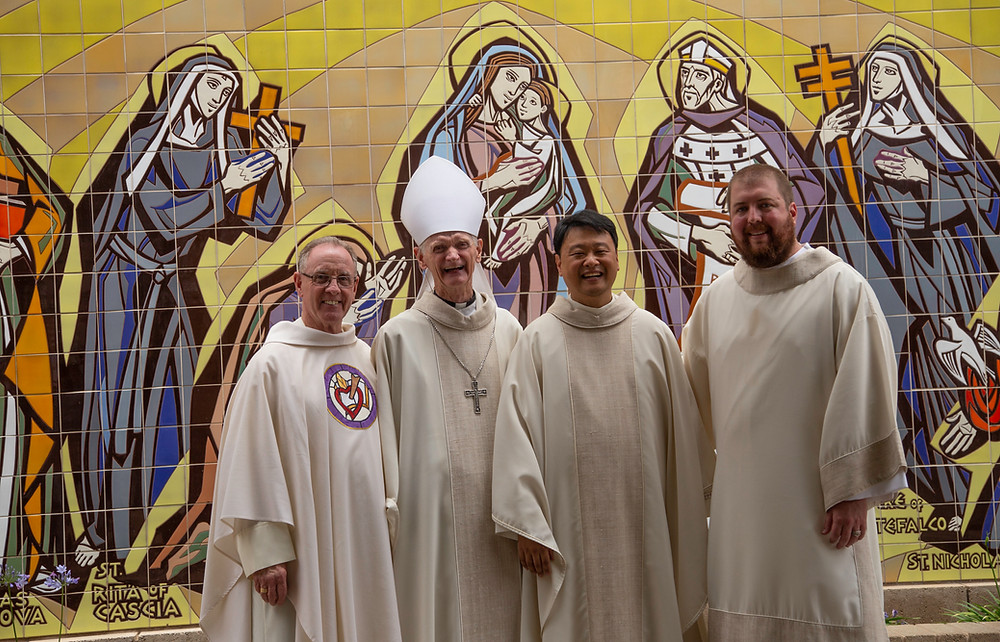 Fr. Phil and Dcn. Max pose with Bishop Turley and Fr. Kevin after Mass