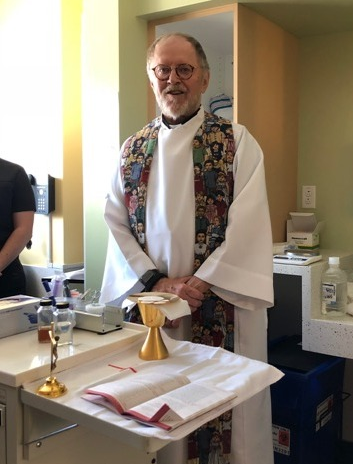 Fr. Jim before Mass is celebrated for a patient