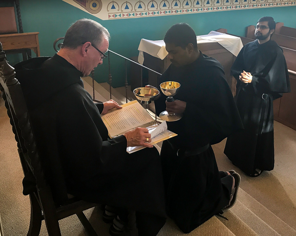Br. Sarfraz is presented the Chalice and Paten, symbols of the office of Acolyte