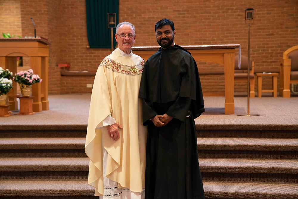 Br. Manny poses for a picture with Fr. Kevin after his First Vows