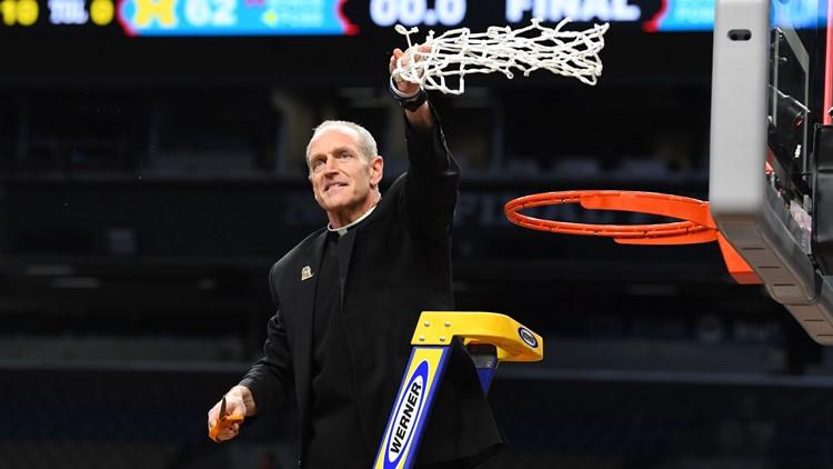 Fr. Rob Cuts Down Net