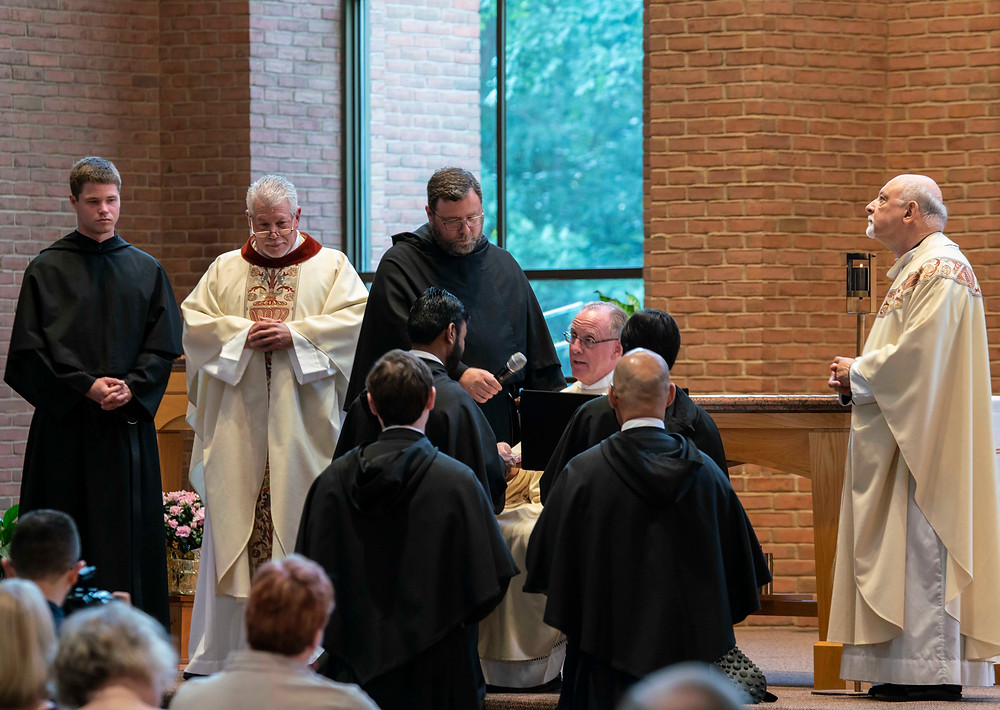 Br. Manny receives the Rule of St. Augustine from Fr. Kevin