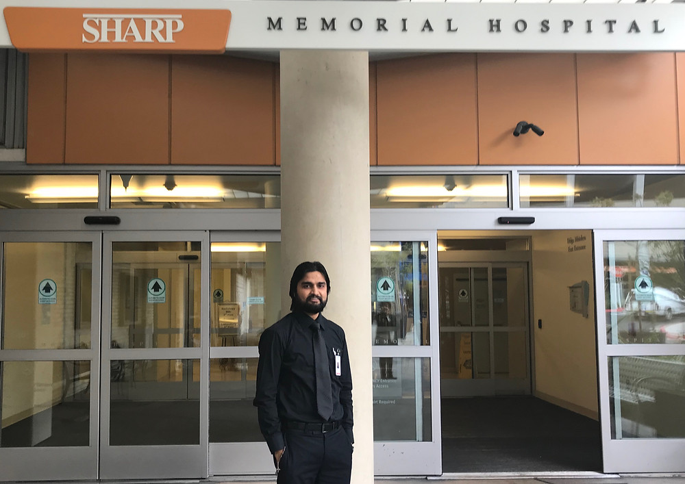 Br. Adnan in front of Sharp Memorial Hospital, where he is enrolled in CPE