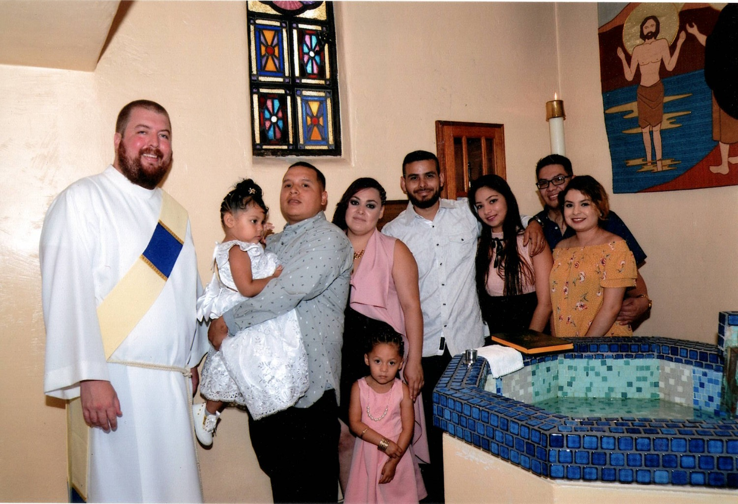 Deacon Max and a family pose for a picture