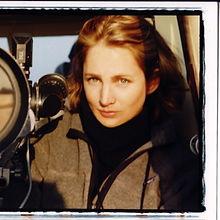Cynthia Pushek with a camera lens