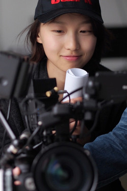 Becky Baihui Chen looks natural behind the camera
