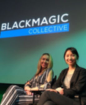 Shelby Adair and Becky Baihui Chen smile as they accept their award on stage at the Blackmagic Colle