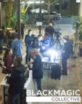 Blackmagic Collective meeting attendees explore lighting and camera options while networking