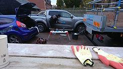sign writing a fleet of scaffolding trucks using cast vinyl material.