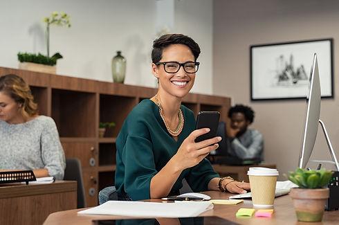 stylish-business-woman-using-smartphone-