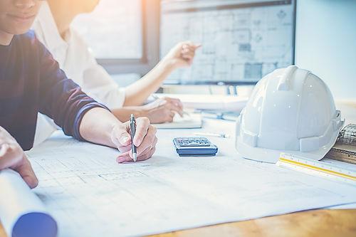 engineer-design-working-on-blueprint-pla