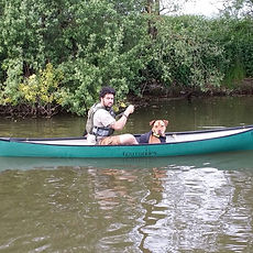Pack Dog Walks go canoeing on the river