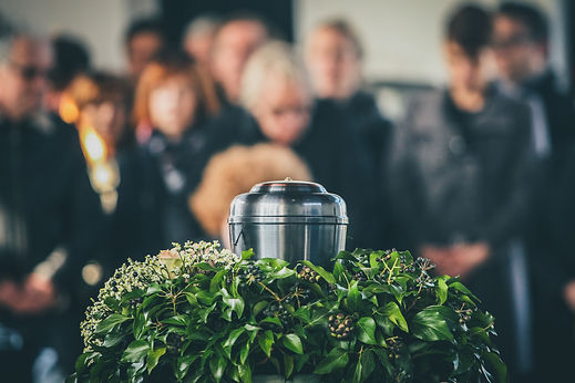 A metal urn with ashes of a dead person