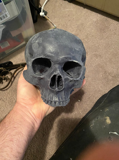 Skull candle (funeral flowers)